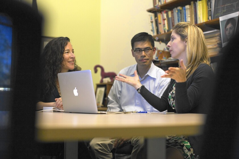 Professor Nancy Lape, right, discusses one of her online chemistry lectures with professors Rachel Levy and Darryl Yong. The Harvey Mudd College instructors are running an experiment to see whether students learn better in traditional classes or courses with an online element.