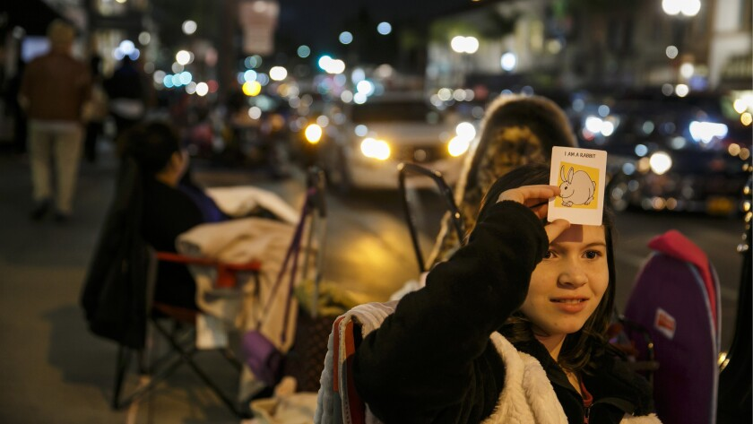 Hailey Cox, 10, plays a game with her grandmother, Linda Betts, not pictured, as they settle in for the evening on Colorado Boulevard.
