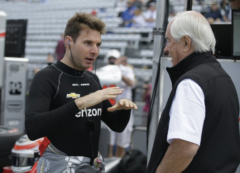 Will Power, of Australia, talks with Roger Penske during a practice session on the opening day of qualifications for the Indianapolis 500 auto race at Indianapolis Motor Speedway in Indianapolis, Saturday, May 21, 2016. (AP Photo/Darron Cummings)