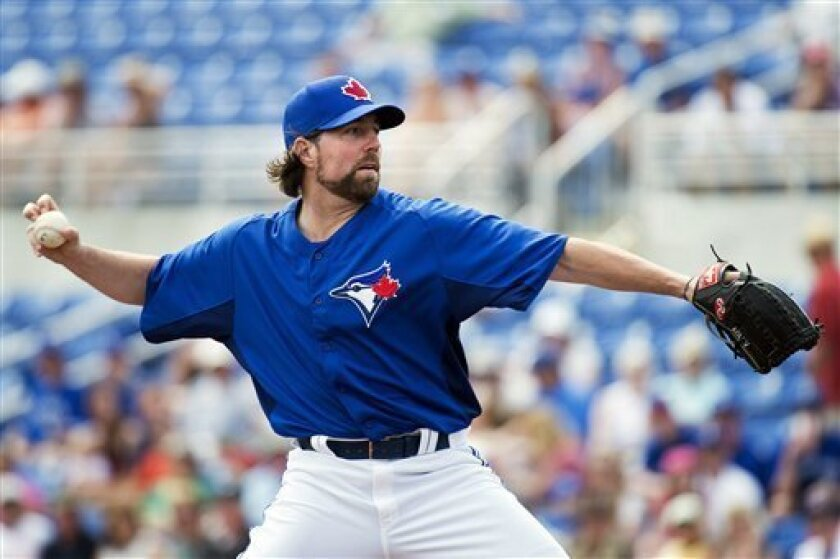 Toronto Blue Jays starting pitcher R.A. Dickey throws against the Boston Red Sox during the first inning of their exhibition spring training baseball game, Monday, Feb. 25, 2013, in Dunedin, Fla. (AP Photo/The Canadian Press, Nathan Denette)