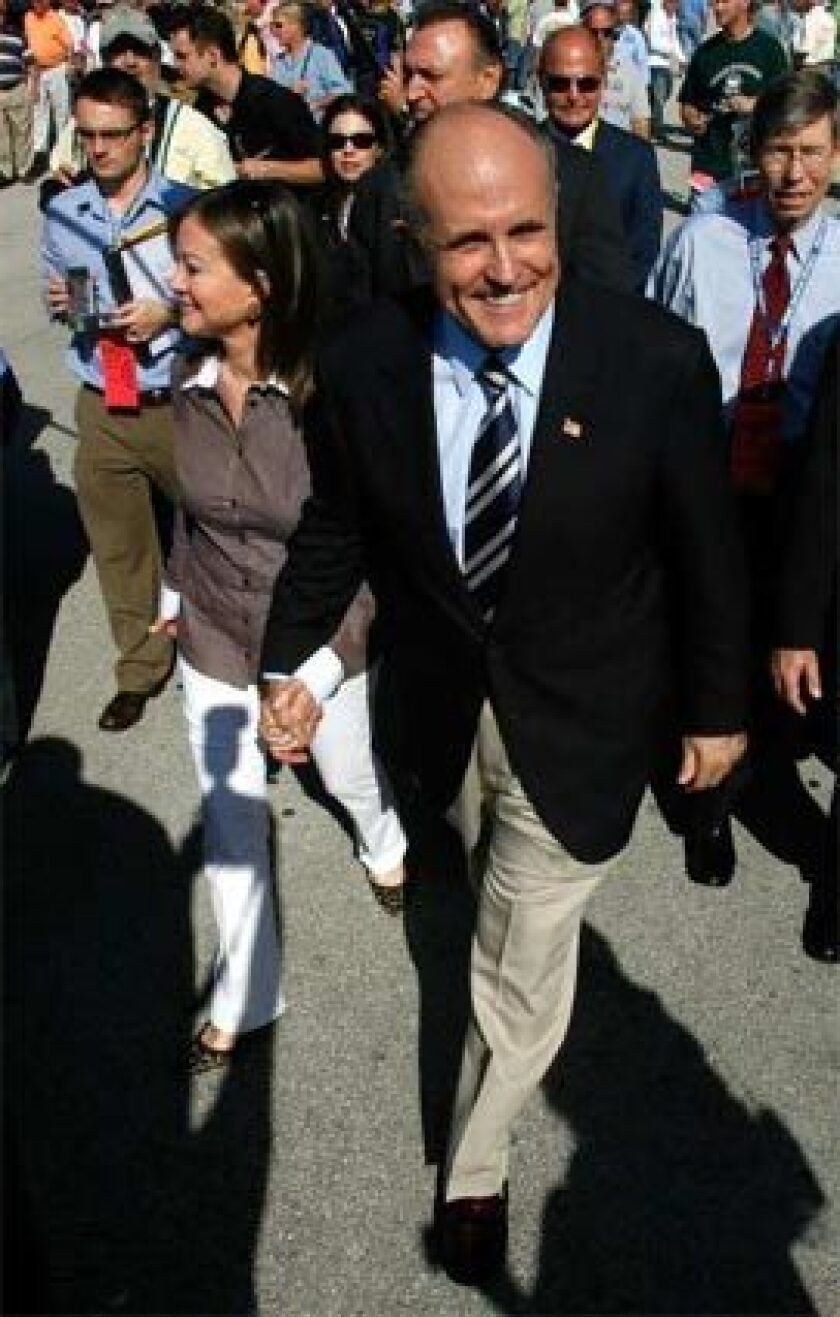 IN FLORIDA: Rudolph W. Giuliani and his wife, Judith, attend the NASCAR race in Homestead on Sunday.