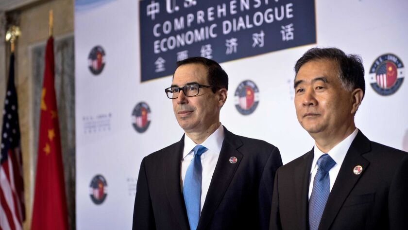 Treasury Secretary Steven T. Mnuchin, left, and Chinese Vice Premier Wang Yang appear at the Treasury Department in July 2017.