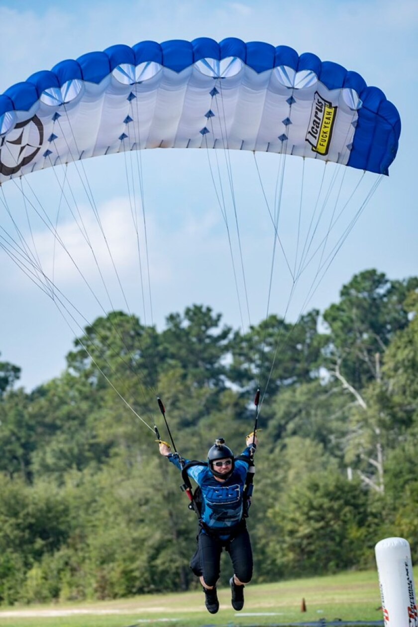 Bryan Buffaloe, 34, of San Diego navigates the course during the advanced canopy piloting finals at the United States Parachute Association's National Parachuting Championships in North Carolina last week. Buffaloe won both the gold medal for advanced canopy speed flying and the overall gold medal for advanced canopy piloting.