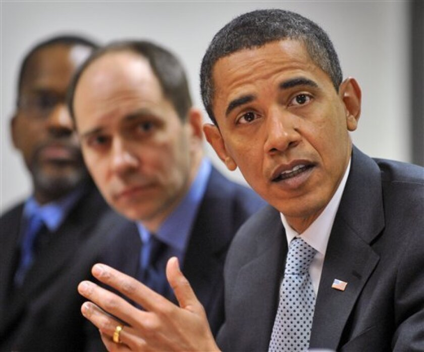 President-elect Barack Obama, right, talks with the Washington Post editorial board Thursday, Jan. 15, 2009 at the Washington POST offices in Washington. L-R:  Executive Editor Marcus Brauchli, White House correspondent Michael Fletcher, and Obama.   (AP Photo/Pool, Bill O'Leary)