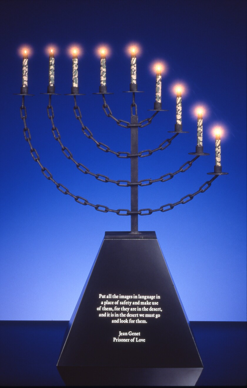 "John Boskovich, ""Bondage Menorah,"" 1997. Metal, black formica base with Jean Genet text, U.S. issue camouflage Mini-Maglites, 41.5 inches by 30 inches by 16.5 inches"