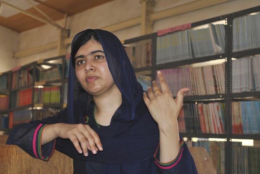 Nobel Peace laureate Malala Yousafzai visits a school in Maiduguri, Nigeria, on July 18.