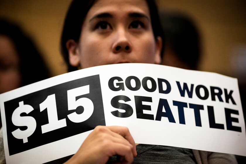 Supporters of the minimum wage increase gathered at Seattle City Hall prior to Monday's vote.