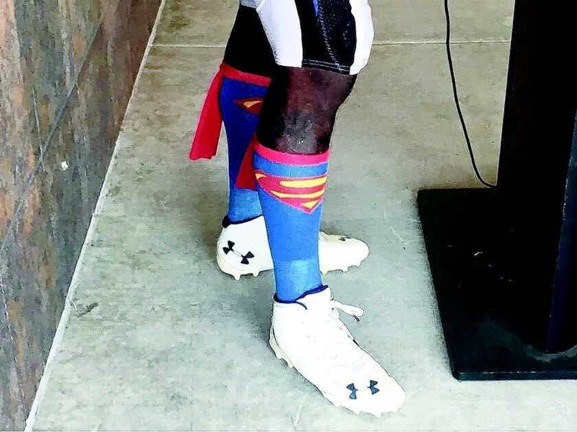 Melvin Ingram's Superman socks caused a stir on social media. Michael Gehlken photo • U-T