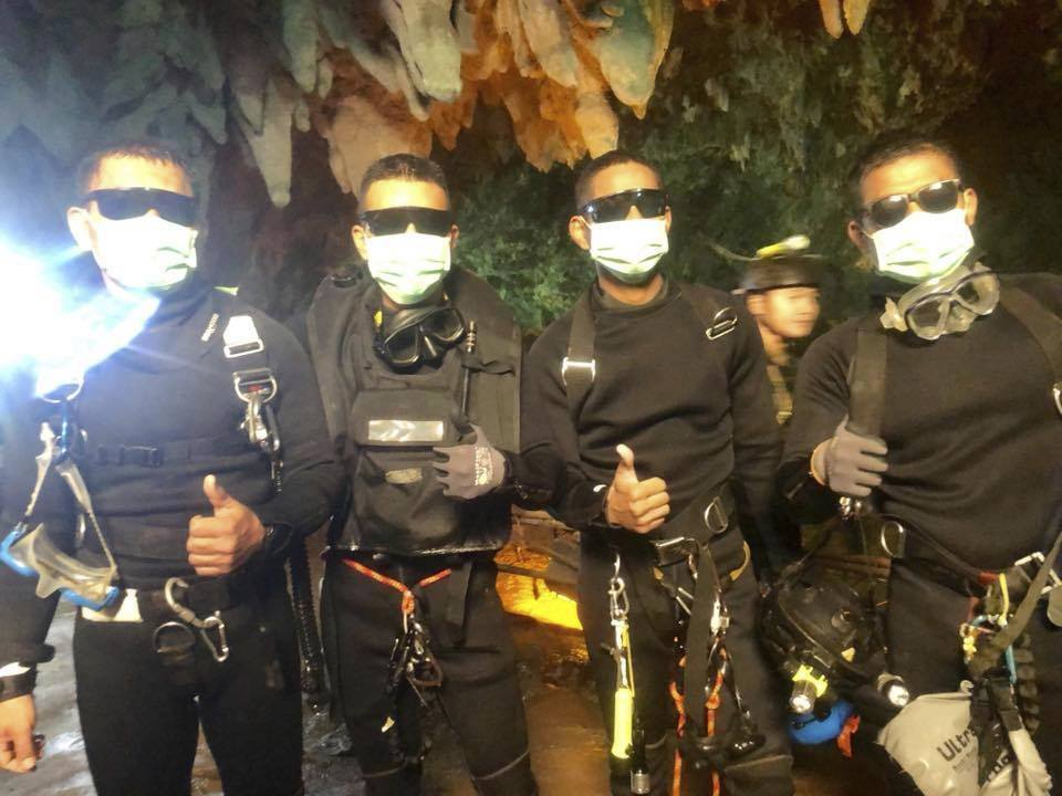 The last four Thai navy SEALs come out safely July 10 after completing a rescue mission inside a cave near Mae Sai where 12 boys and their soccer coach were trapped.