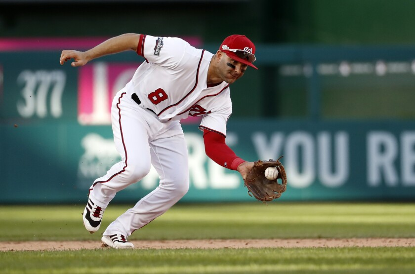 Washington Nationals shortstop Danny Espinosa (8) fields a ground ball during Game 2 of baseball's National League Division Series against the Los Angeles Dodgers, at Nationals Park, Sunday, Oct. 9, 2016, in Washington. The Nationals won 5-2.