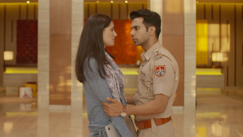 "Nargis Fakhri and Rajkummar Rao in the movie ""Five Weddings."""