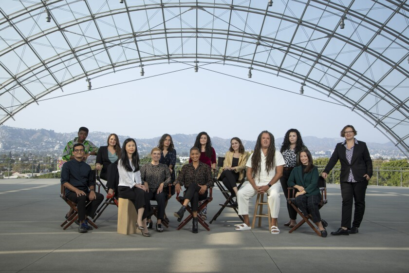 The 13 curators at the Academy Museum, photographed under the glass dome of the new viewing terrace.
