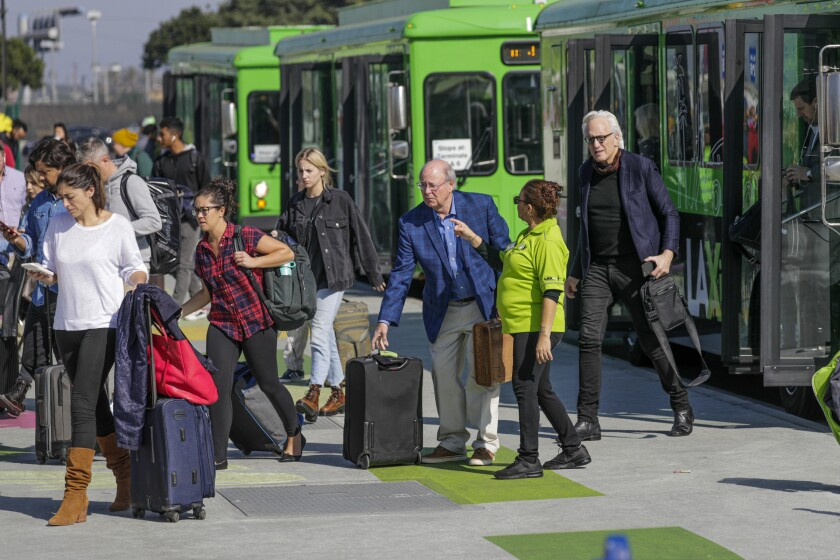 "Passengers arrive at the ""LAXit"" lot"