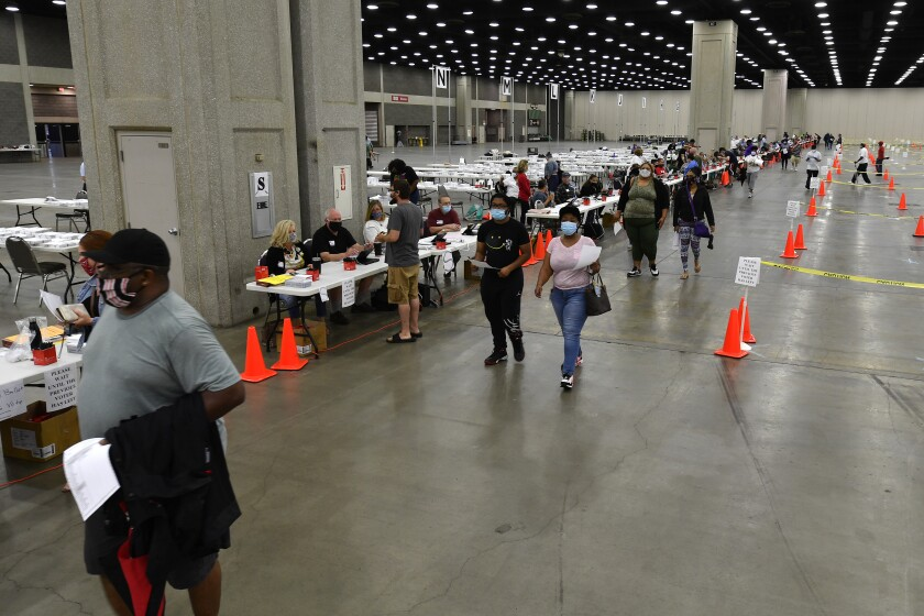 Voters at the Kentucky Exposition Center in Louisville.