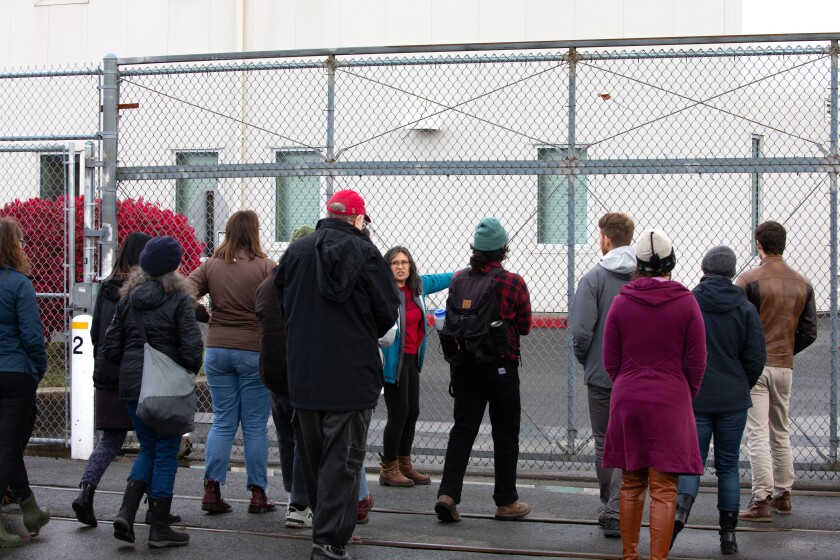 Maru Mora-Villalpando, an activist with La Resistencia and Mijente, leads a protest Oct. 19 outside the Northwest ICE Processing Center in Tacoma.