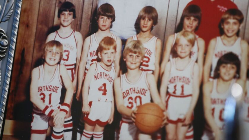 A photograph of Mick Cronin (4) from the mid 1970s when he played basketball with the Cincinnati Kni