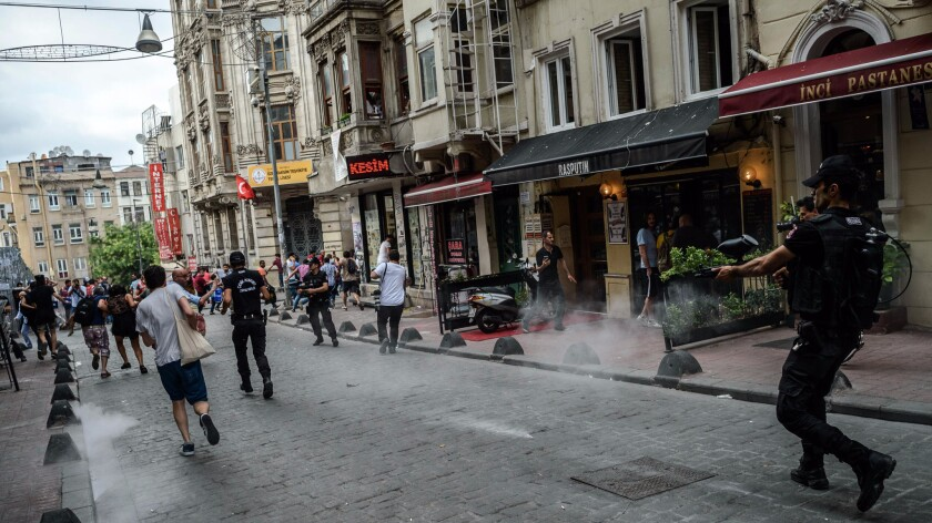 Turkish anti riot police fire rubber bullets to disperse demonstrators gathered for a rally staged by the LGBT community in Istanbul on June 26, 2016.