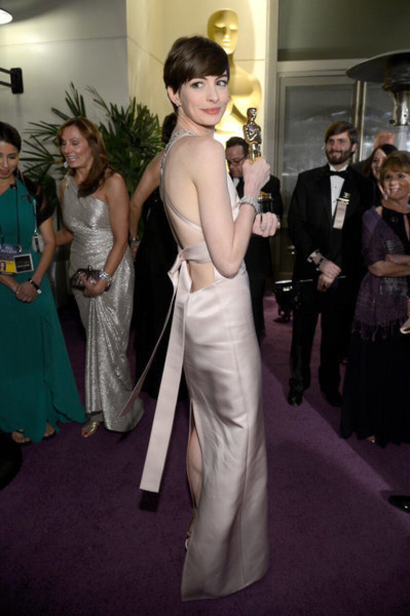 Why Anne Hathaway wore Prada, not Valentino, to the Oscars