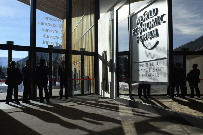Businessmen cast shadows during the 48th annual meeting of the World Economic Forum, WEF, in Davos, Switzerland, on Jan. 24, 2018 The meeting brings together enterpreneurs, scientists, chief executive and political leaders in Davos January 23 to 26.