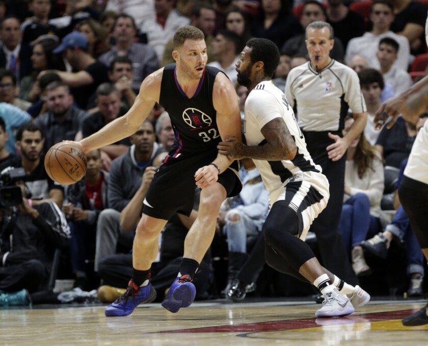 Clippers forward Blake Griffin drives to the basket as Miami Heat forward James Johnson defends during the second half on Dec. 16.