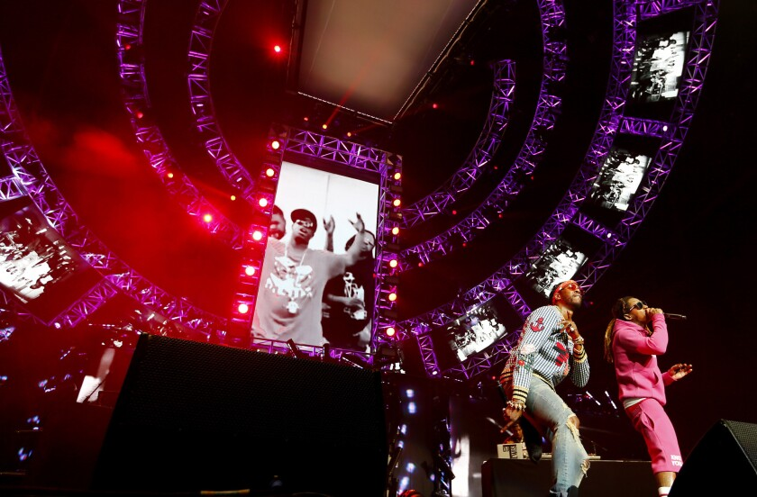 Saturday's hip-hop showcase at the BET Experience was headlined by 2 Chainz, left, and Lil Wayne.