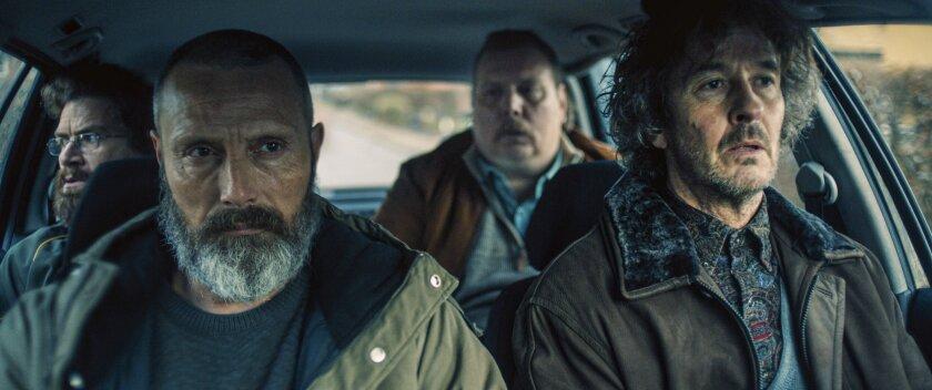 """Nikolaj Lie Kaas, from left, Mads Mikkelsen, Nicolas Bro and Lars Brygman in the movie """"Riders of Justice."""""""