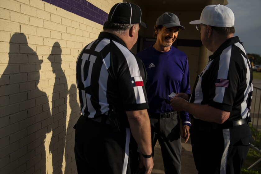 Mount Vernon High School Tigers head coach Art Briles chats with the referees before a game at Bonham High School on Friday in Bonham, Tex.