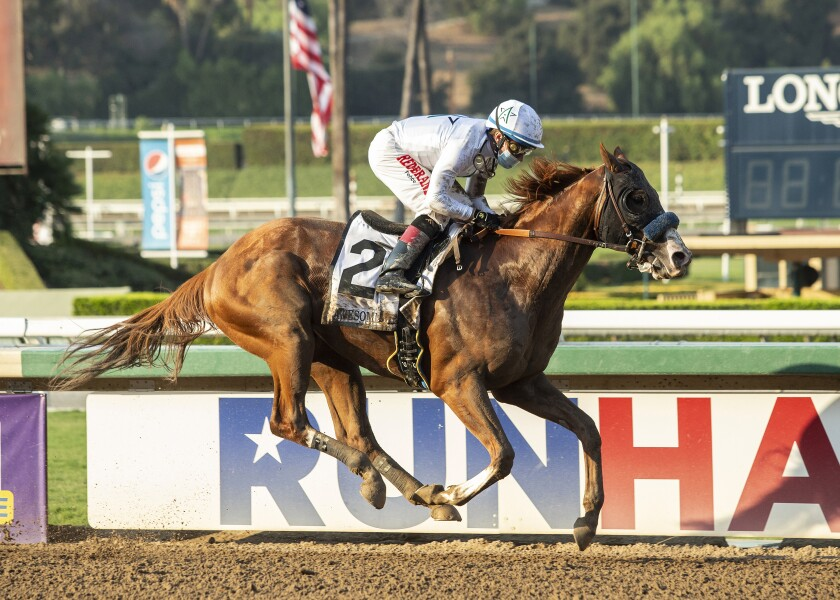 Improbable, with Drayden Van Dyke aboard, races in the Grade 1 Awesome Again Stakes at Santa Anita on Saturday.