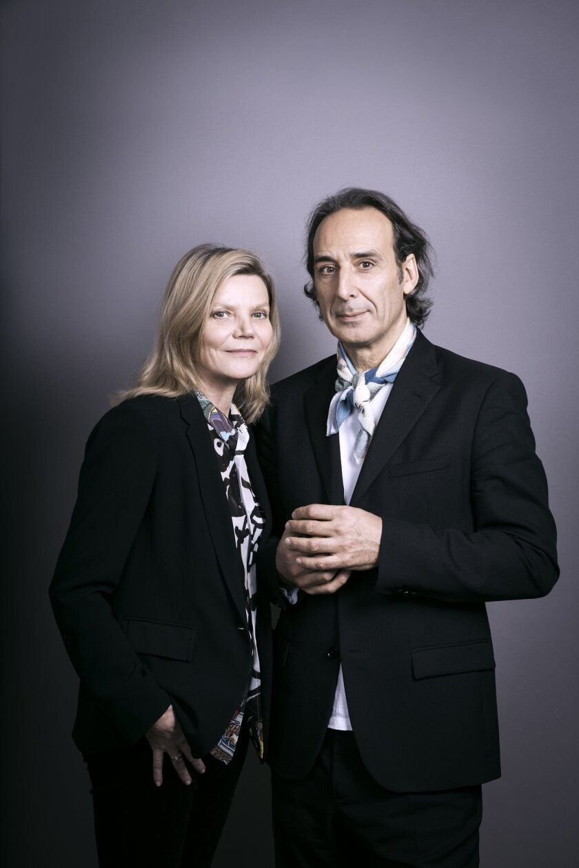 Caption: Solrey and Alexandre Desplat. Desplat's wife factors into the story prominently and is di
