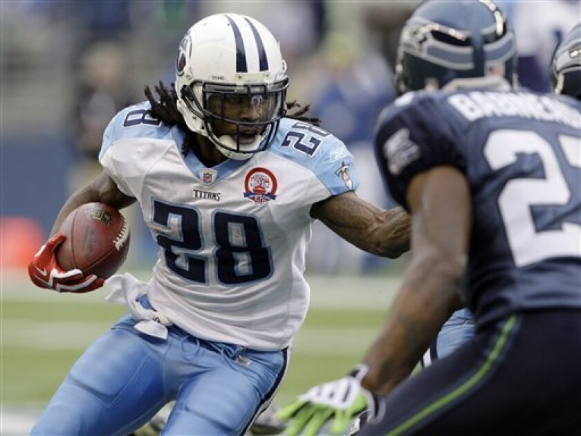 Tennessee Titans' Chris Johnson (28) rushes against Seattle Seahawks' Jordan Babineaux, right, in the second half, Sunday, Jan. 3, 2010, during an NFL football game in Seattle. (AP Photo/Elaine Thompson)