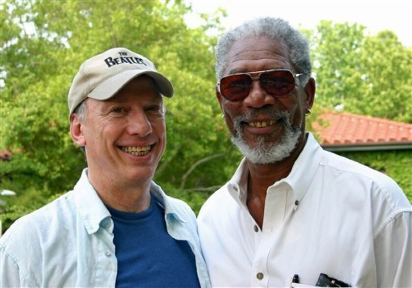 """In this undated  image released courtesy of Paul Saltzman, Academy Award-winner, Morgan Freeman, is shown with Paul Saltzman, the director of the documentary, """"Prom Night in Mississippi"""". (AP Photo/Courtesy Paul Saltzman)"""
