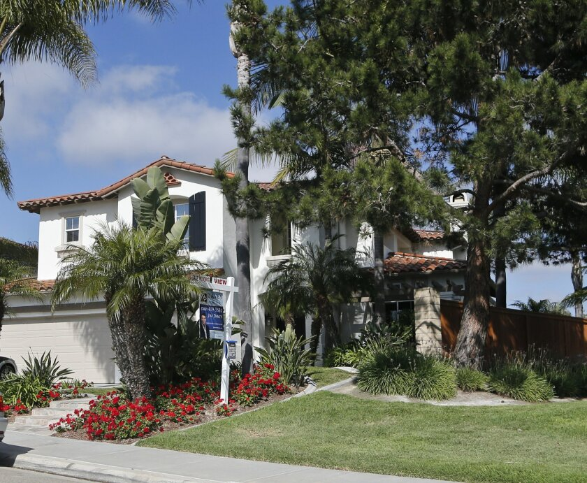This Thursday, May 26, 2016, photo shows a home with a sale pending in Carlsbad, Calif. On Thursday, June 2, 2016, Freddie Mac reports on the week's average U.S. mortgage rates. (AP Photo/Lenny Ignelzi)
