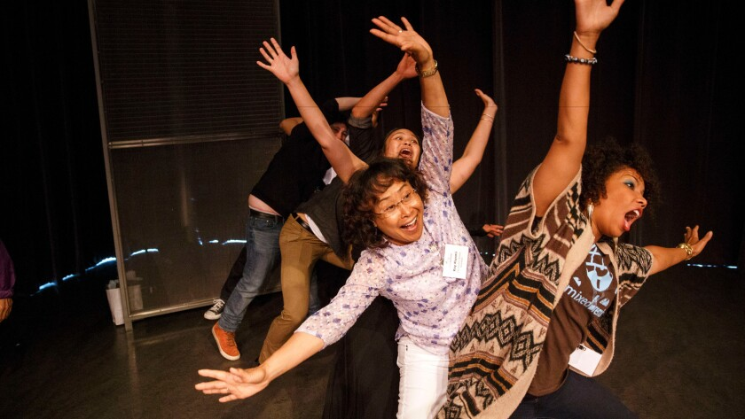 Pamela Capalad Kushner, rear left, Kay Kiyomi, center, and My-Ishia Cason-Brown, right, improv a roller coaster ride during an improv workshop during the Mixed Remixed Festival on Friday, June 10.