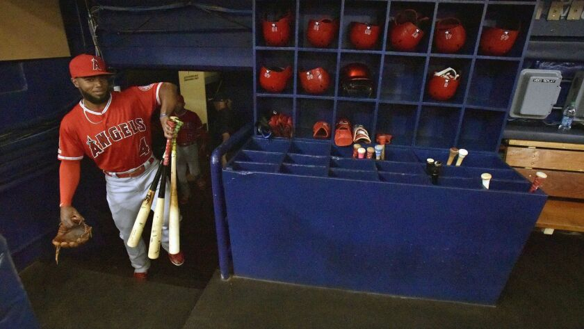 Los Angeles Angels' Luis Rengifo (4) carries his gear into the dugout before a baseball game against