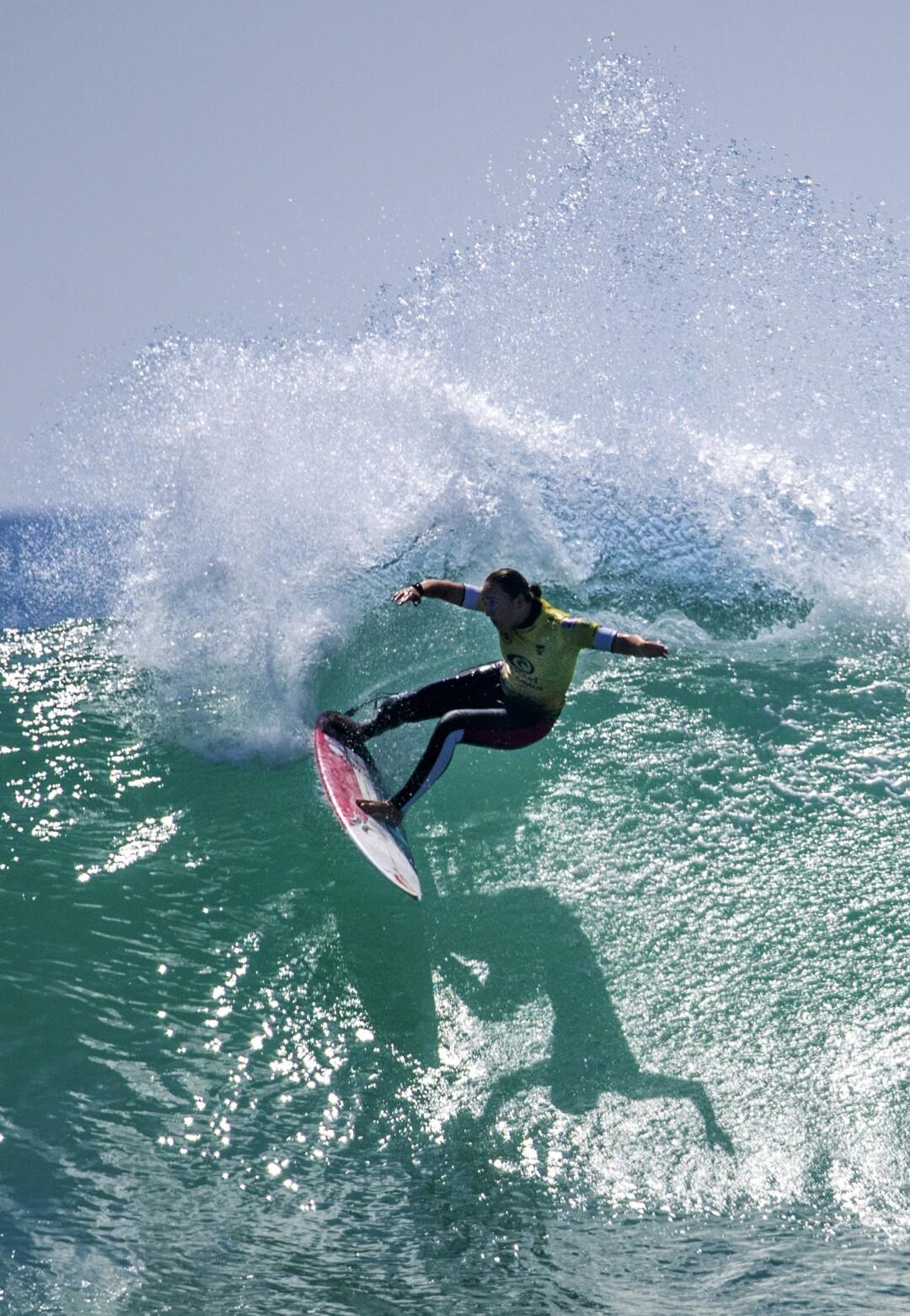 Carissa Moore turns off the top of a big wave against Tatiana Weston-Webb