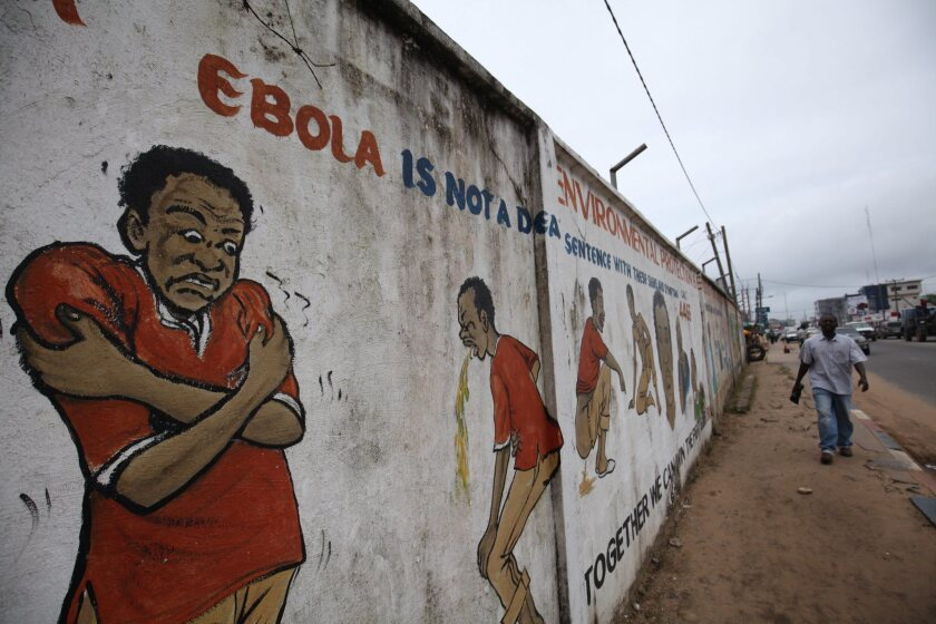 A mural on a street in Monrovia, Liberia, conveys mesages about the deadly Ebola virus.