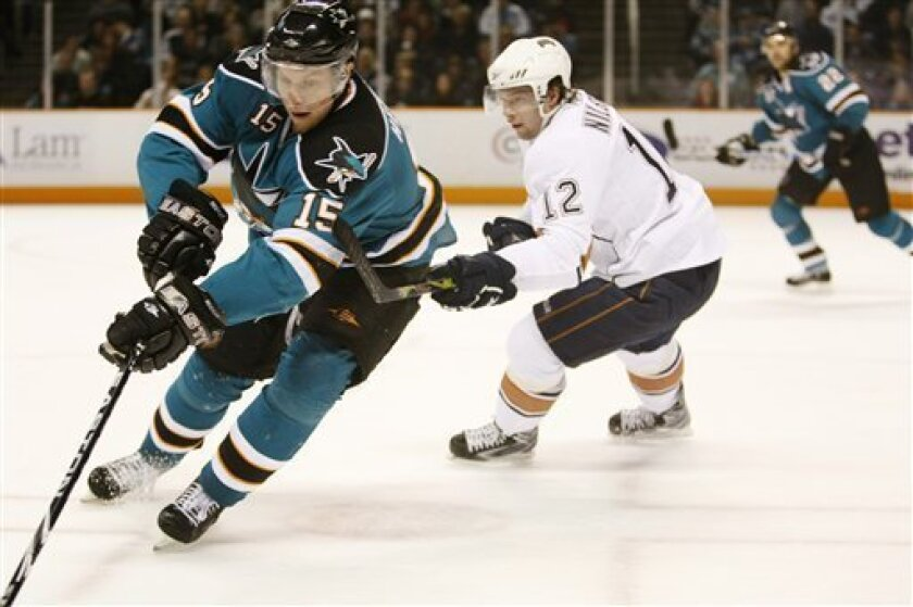 San Jose Sharks right wing Dany Heatley, left, is chased by Edmonton Oilers center Robert Nilsson during the second period of an NHL hockey game in San Jose, Calif., Saturday, Jan. 2, 2010. (AP Photo/Marcio Jose Sanchez)