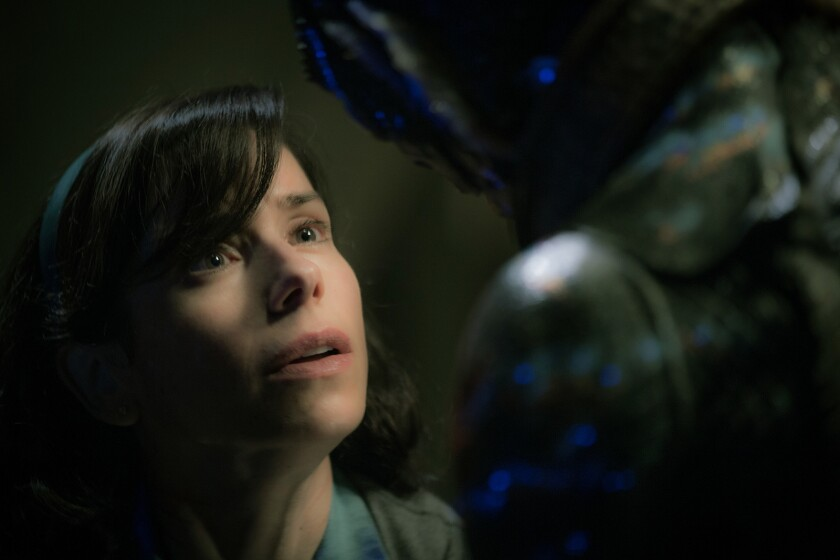 """(L-R) - Sally Hawkins and Doug Jones in the film """"THE SHAPE OF WATER."""" Credit: Kerry Hayes / Fox Se"""