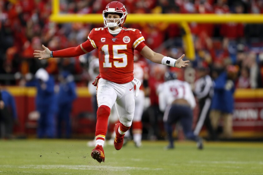 Kansas City Chiefs quarterback Patrick Mahomes (15) celebrates after throwing a touchdown pass during the second half of an NFL divisional playoff football game against the Houston Texans, in Kansas City, Mo., Sunday, Jan. 12, 2020. (AP Photo/Jeff Roberson)