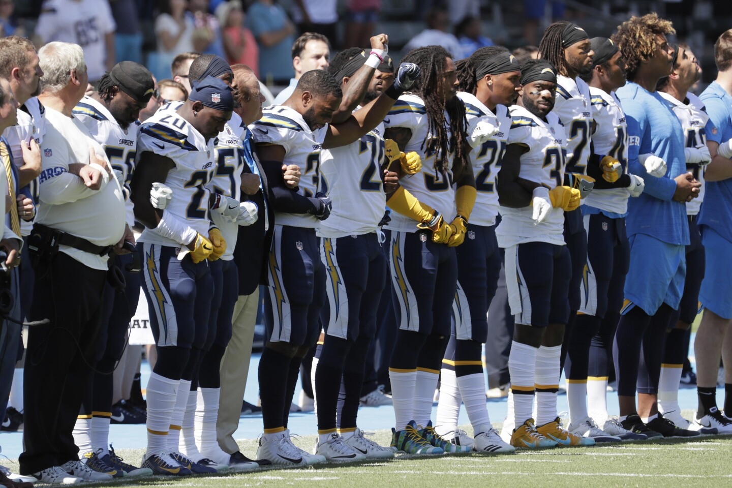 The San Diego Chargers link arms during the national anthem in a game against the Kansas City Chiefs at StubHub Center. (Robert Gauthier/Los Angeles Times)