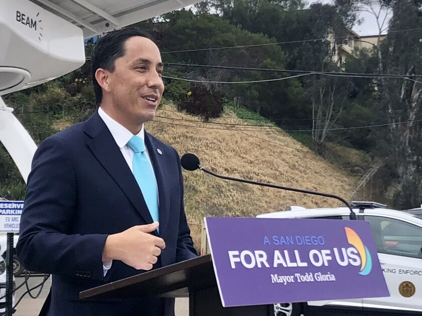 Mayor Todd Gloria at a news conference announcing a pilot program for electric vehicle charging.