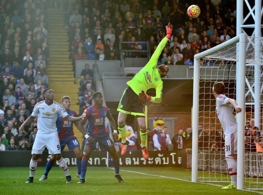 Manchester United goalkeeper David De Gea tips the ball over the crossbar during their English Premier League soccer match against Crystal Palace at Selhurst Park, London, Saturday, Oct. 31, 2015. (Anthony Devlin/PA via AP)     UNITED KINGDOM OUT       -     NO SALES     -    NO ARCHIVES