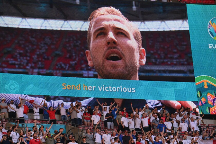 England fans stand for the anthem before the Euro 2020 soccer championship group D match between England and Croatia at Wembley stadium in London, Sunday, June 13, 2021. (Glyn Kirk/Pool Photo via AP)