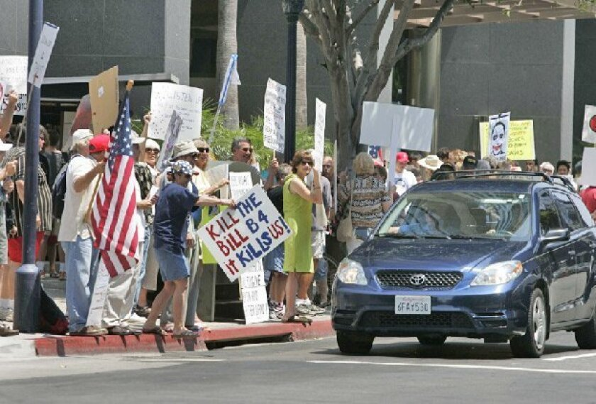 Protesters downtown made their feelings known about health care reform. 