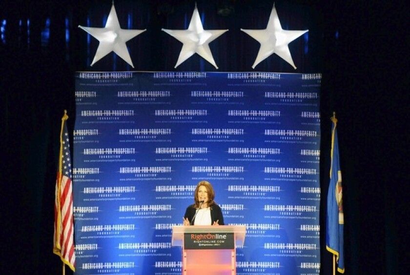 Rep. Michele Bachmann (R-Minn.) speaks at a conference in Minneapolis. Republican strategists warn that she needs to square her fiscal record with her public pronouncements.