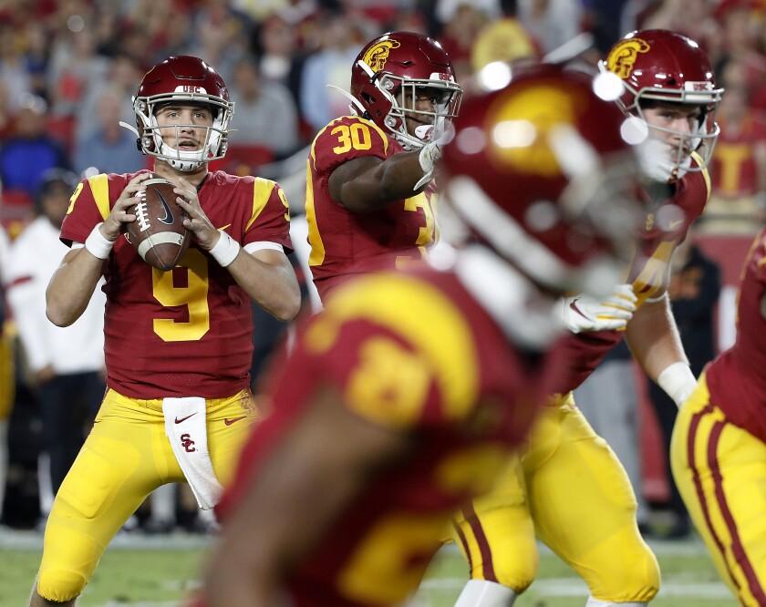 USC quarterback Kedon Slovis looks for an open man downfield against Arizona on Saturday night.