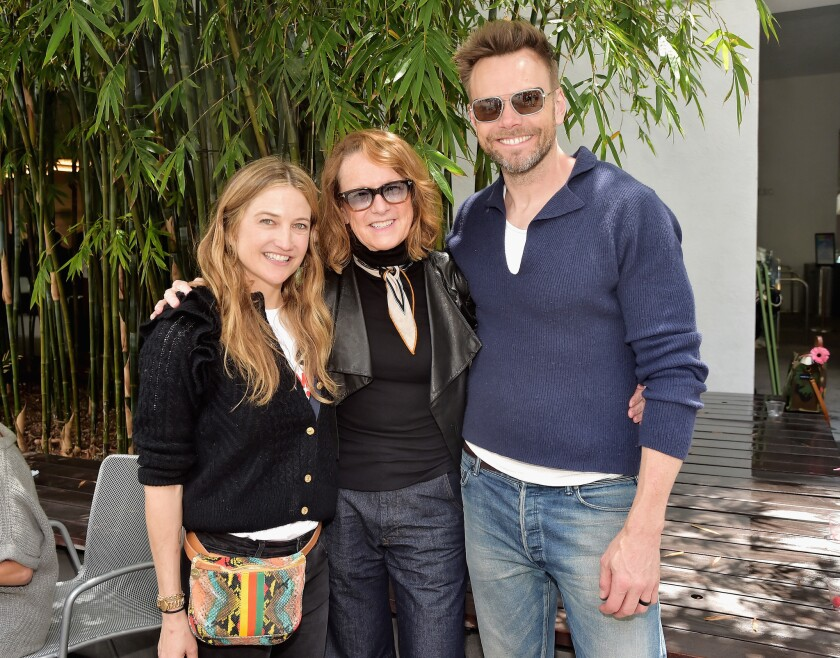 Event co-chair Sarah McHale, left, and her actor-comedian husband, Joel McHale, join Hammer Museum director Ann Philbin.