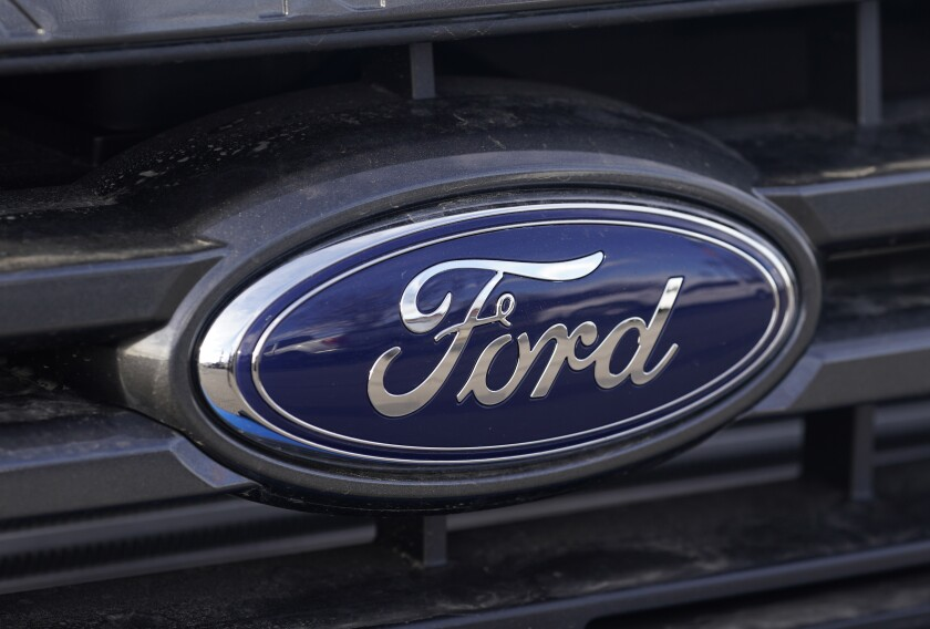 This April 25, 2021 photo shows the blue oval logo of Ford Motor Company in east Denver. Ford say, Thursday, Sept. 9, it's going to stop making vehicles for sale in India immediately as part of its efforts to return its business there to profitability, resulting in the loss of approximately 4,000 jobs. (AP Photo/David Zalubowski)
