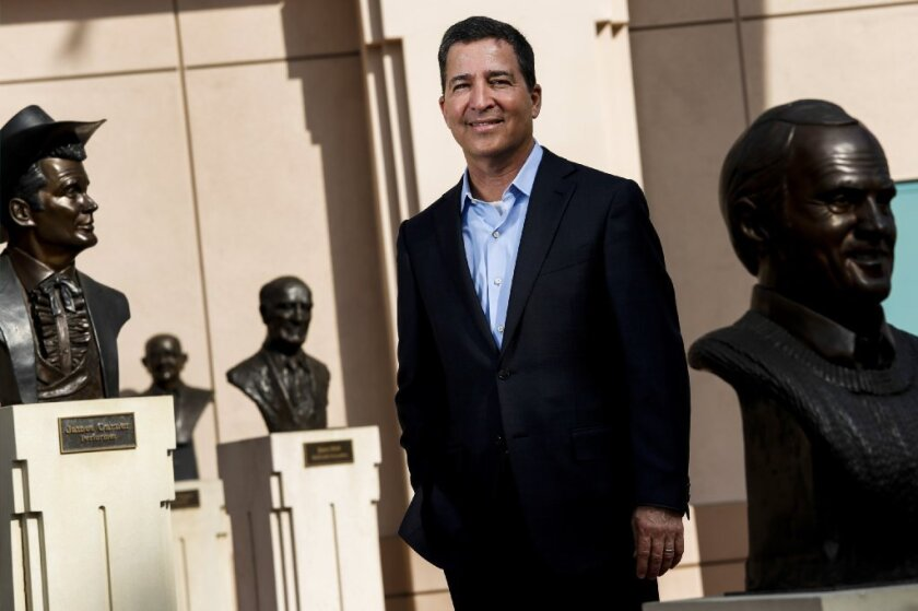 Bruce Rosenblum, chairman and CEO of the Television Academy, with some of the busts of past stars outside the academy's North Hollywood headquarters.