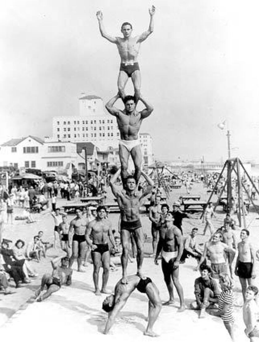 "Local bodybuilder Harold Zinkin poses at the bottom of a human tower of musclemen that includes, in ascending order: Deforrest ""Moe"" Most, Jack LaLanne and Gene Miller, in this undated photo. Muscle Beach was an international magnet for bodybuilders."